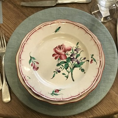 Vintage table set with mixed color flowers