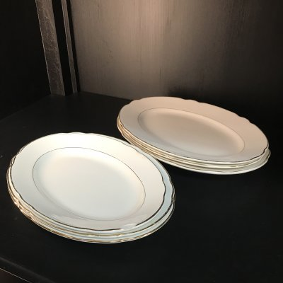 Vintage set of oval serving platters with gold edges