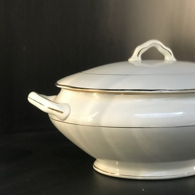 Vintage oval tureen with gold lines and edges