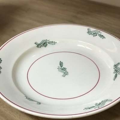 Round vintage platter with red lines and green design