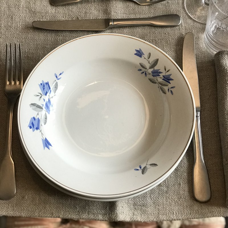 Vintage table set with blue flowers